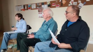 Chandra Wohleber, Leone Rooke and Tony Calzetta study the script on the first day of the workshop.