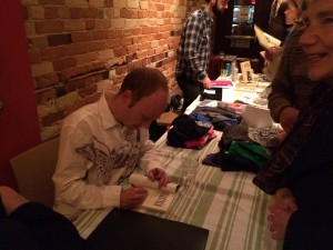 And of course Alec signed copies for his fans. Photo by Miles Dempster.