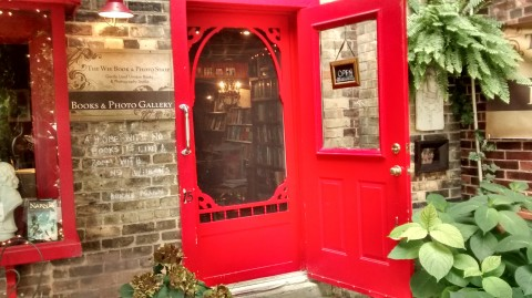Beyond a tiny courtyard was a cheery red door inviting us to enter The Wee Book & Photo Shop. It sure is wee, but that didn't stop me from making a triumphant purchase of a book I'd been coveting!
