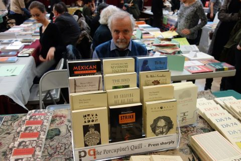 PQL Publisher Tim Inkster, manning a table featuring an impressive array of titles, including hot-off-the-press Portraits of Canadian Writers.
