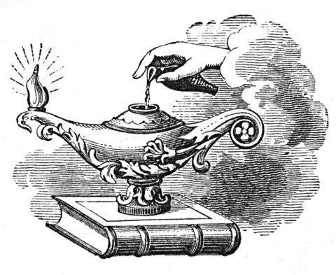 magic lamp sitting atop a book