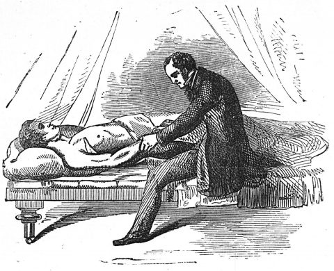 Doctor leaning over patient.