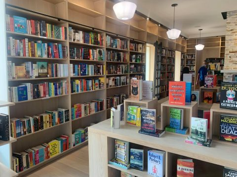 interior of River Bookshop showing tidy displays and shelves full of books