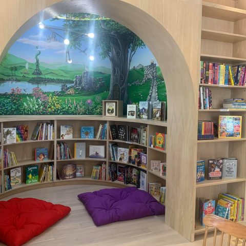 alcove for children's books featuring colourful fantasy mural