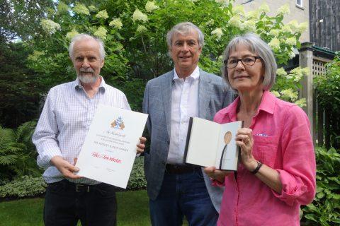Tim Inkster holding certificate, Chester Gryski, Elke Inkster holding medal